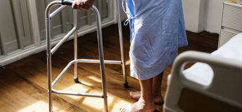 elderly person using a walking frame health and safety in care homes